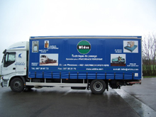 Here is a lorry curtain with lettering and full four-colour printing